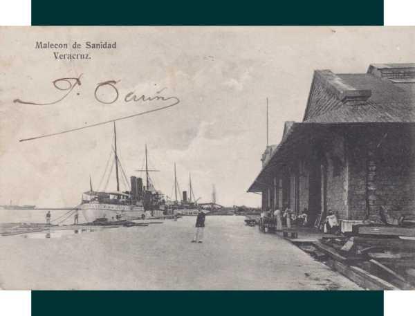 Núm.17.- Malecón de Sanidad; a la derecha, los edificios de Sanidad y a la izquierda, el muelle de la T. Fecha de matasellos: 8 de agosto de 1911. Editada por la Papelería Blanco y Negro.